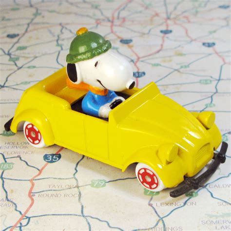 what type of is snoopy snoopy in yellow citroen type car collectpeanuts