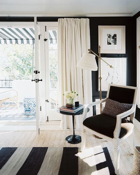 interior design love mark d sikes black living room layered rugs and a brass floor l in