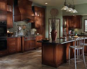 maple cabinets blended with stainless steel appliances and