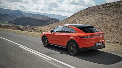 porsche cayenne coupe jumping   fastback suv