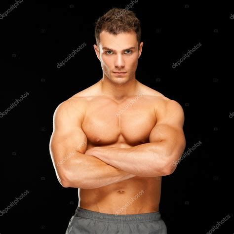 best stock photos of photo handsome man showing cell phone black handsome man with arms crossed looking his left on black