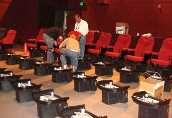 theater with moving seats some theaters trying moving seats in effort to lure