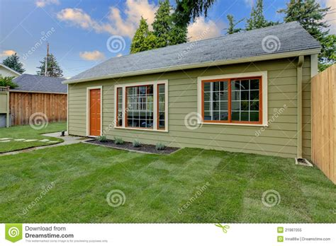 small backyard guest house small green guest house in the fenced backyard stock