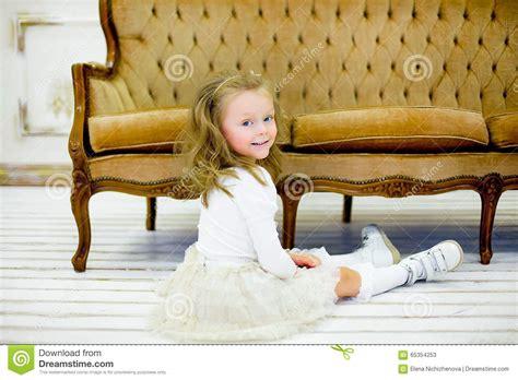 little girls sofa the little girl on a sofa stock photo image 65354253