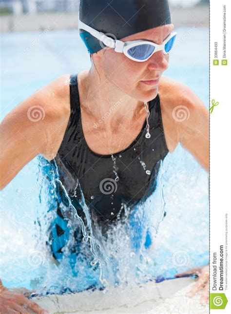 Female Swimmer Hygiene | female swimmer exiting pool stock photos image 33864493