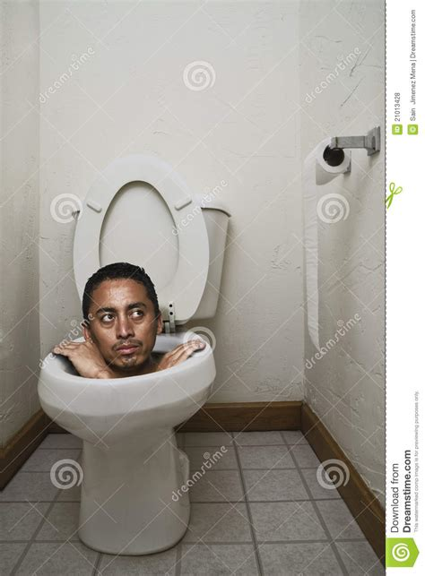 stuck in a bathroom stuck on the toilet stock photo image of potty hang
