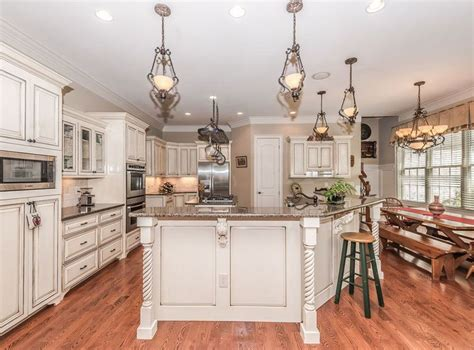 Distressed Antique White Kitchen Cabinets by Antique White Kitchen Cabinets Design Photos