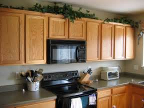 Decorations For Top Of Kitchen Cabinets Decorating Ideas For Kitchen Cabinet Tops Room