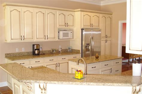 cream cabinets with glaze refinishing with glaze and cream color kitchen cabinets