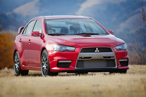 mitsubishi evo red mitsubishi lancer evo x car red wallpaper hd wallpaper