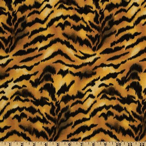 designer animal print upholstery fabric animal print tiger gold black from fabricdotcom designed