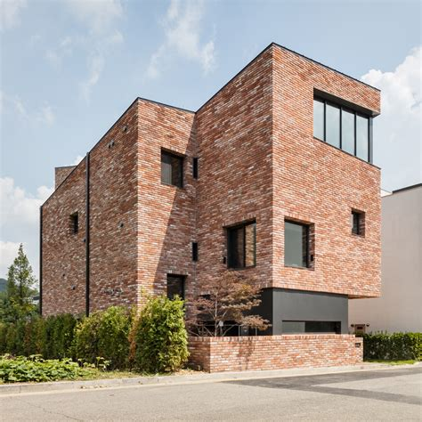 bricks design house although only 10 metres tall this red brick house in south korea by architects aandd