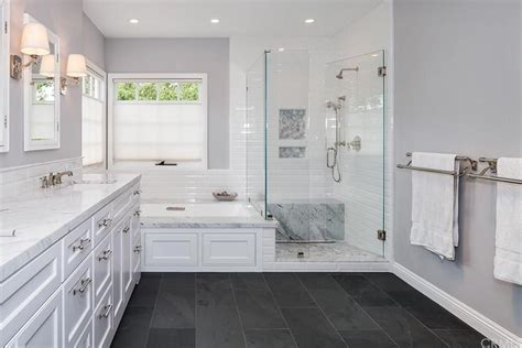 Traditional Master Bathroom with Complex marble counters & Wall sconce in Newport Beach, CA