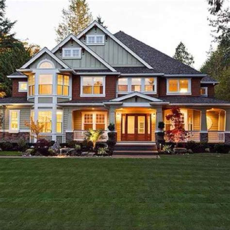 red craftsman style home with wrap around porch charming home with a semi wrap around porch this is beautiful if