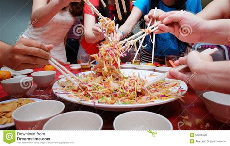 new year tossing of food yu sheng toss also known by 2015 yee sang