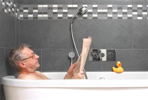 man in a bathtub healthy aging sneaky depression triggers in pictures
