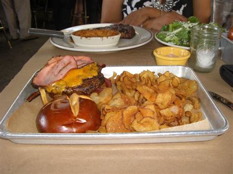 Vinsetta Garage Reservations by Burger With Smoked Cheddar Canadian Bacon Pretzel Bun