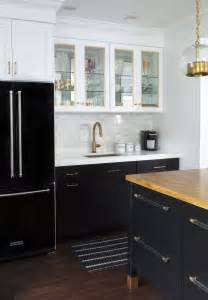 Black Cabinet Kitchens Black Refrigerator With Black Base Cabinets And White Cabinets Marble Subway Tile Brass
