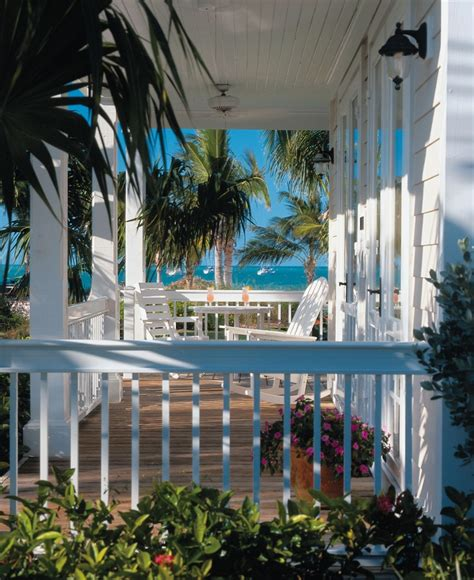 cottage porch at sunset key guest cottages in key west