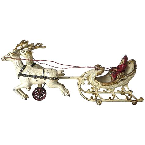santa in the sleigh with two reindeer by hubley circa