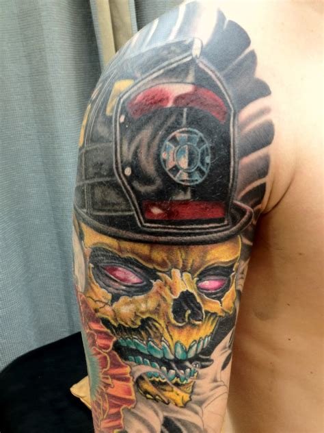 lion skull tattoo firefighter skull shoulder and arm shared by