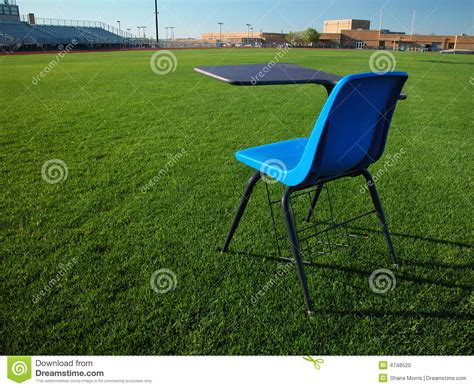 Desk In The Field by Student Desk On Football Field At School Stock Photo