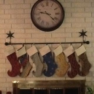 hang stockings without mantle found a way to hang the without a mantle brick hooks and a curtain rod made