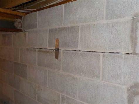 extensive wall crack in block basement wall crumbling