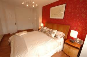 red bedroom wall paper mixed white painted design combined with feature double bed satin throw