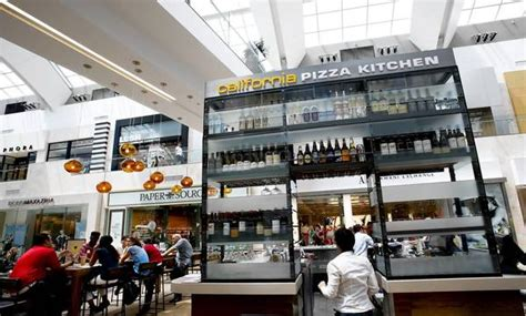 California Pizza Kitchen Mall by California Pizza Kitchen Tries A New Look Rustic