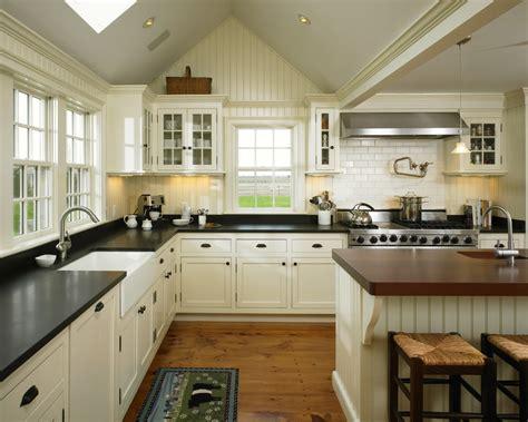 white cabinets and black countertops black farmhouse kitchen farmhouse with large range
