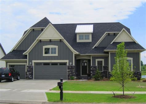 rock pattern vinyl siding dark grey house with siding stock image new house