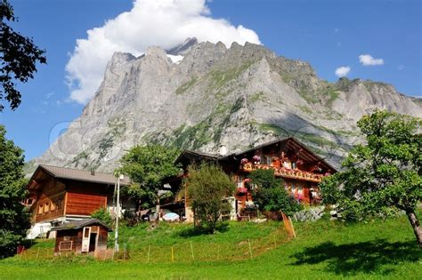 houses to buy in switzerland mountain alp farmer houses in switzerland stock photo colourbox