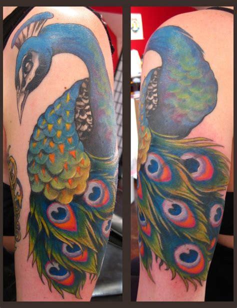 new school peacock tattoo peacock color tattoo by gene coffey tattoonow