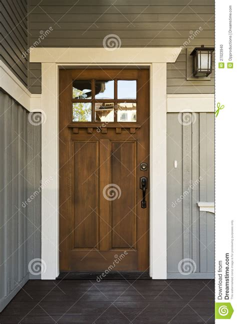 French Country Home Accents - dark wood front door of a home stock photo image 27023940
