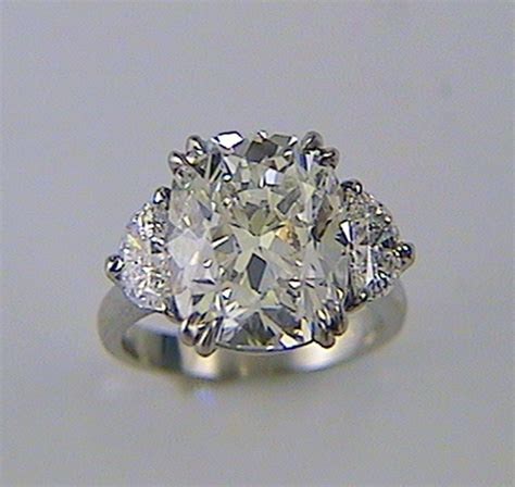 cushion cut engagement ring with half moon sides