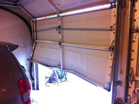 Garage Door Bottom Panel Replacement Backed Into Garage Door Neiltortorella