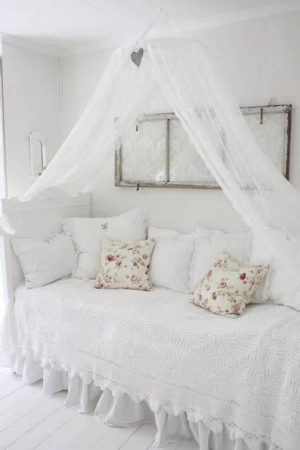 The All White Bed Style All White With Textural Elements In The Sham Canopy Is An