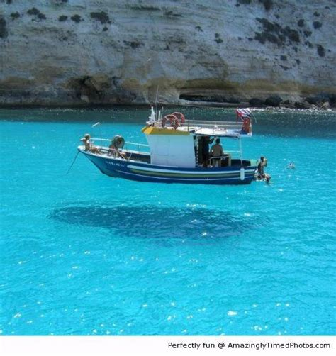 floating boat photo floating boat on clear blue water amazing photo the