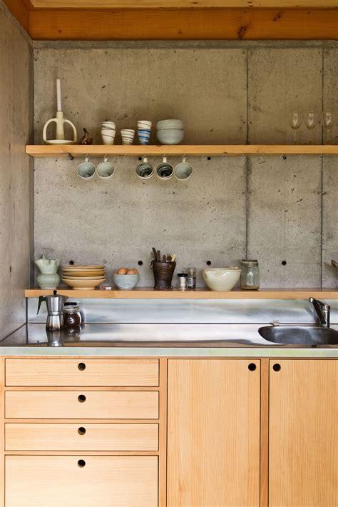 concrete slab walls  wooden bench cupboard kitchen