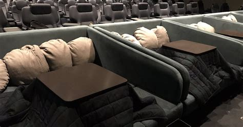 kotatsu bed japanese movie theater offers special kotatsu table section