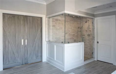 bathroom barn doors transitional bathroom baines