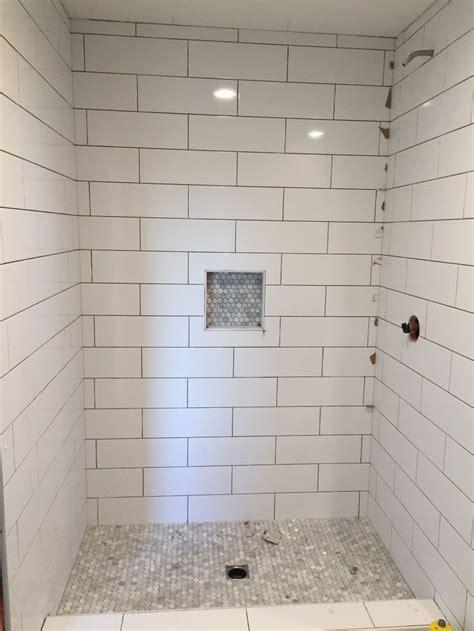 large subway tile  mosiac shower pan  niche