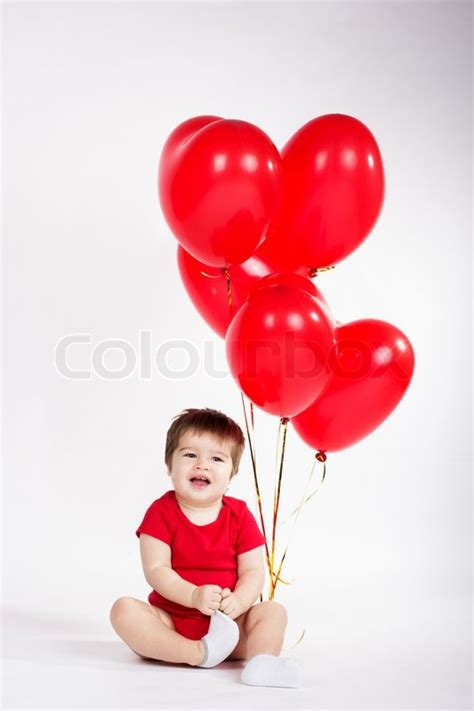 newborn valentines day baby boy with balloons valentines day stock