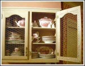 makeover a cabinet door with chicken wire panels chicken