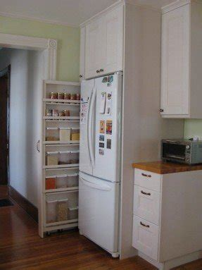 marvelous Kitchen Cabinet Broom Closet #3: when-emilie-remodeled-her-kitchen-she-planned-for-this-rolling-pantry-which-is-just-narrow-enough-to-slide-in-beside-her-refrigerator-7-ways-slim-storage-saves-the-day-small-space-solutions.jpg