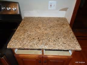 granite countertop corner kitchen sink cabinets glass