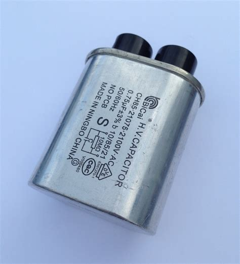 capacitor in a microwave emerson mw7300w microwave hv capacitor ch85 21075 2100v 75uf microwave parts accessories