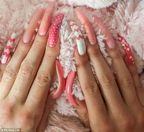 new year cut fingernails german student has 6in nails after three years