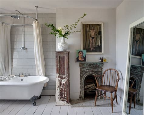 Foot tub white tile subway tile white walls and painted wood floors